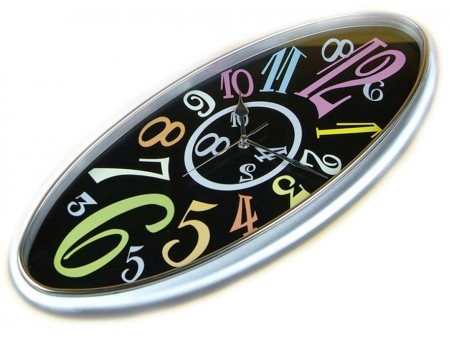 Horloge design ovale multi couleurs Holly pour 59€